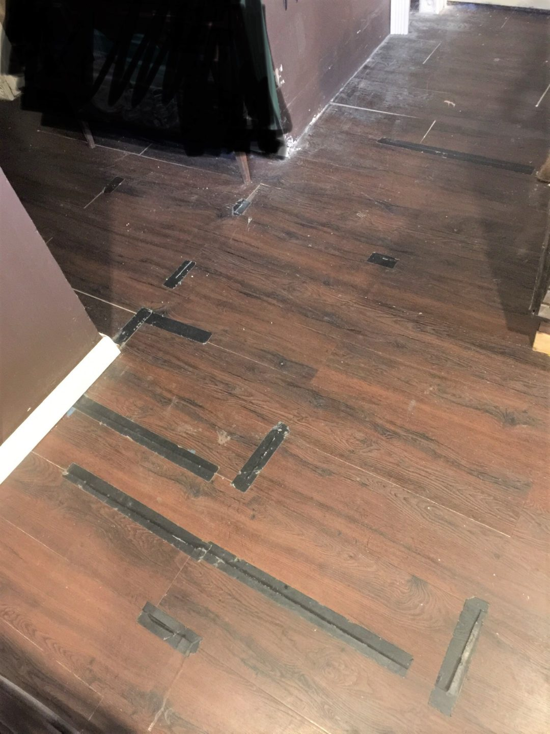The Black Tape Blends Right In, Right? ugly floor contest entry photo